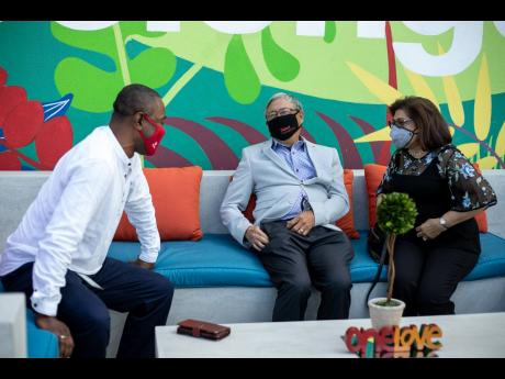From left: Digicel Jamaica Chairman Harry Smith (left), PRO Communication's Hubert Chin, and Chairman of the Digicel Foundation, Jean Lowrie-Chin, share a light moment.