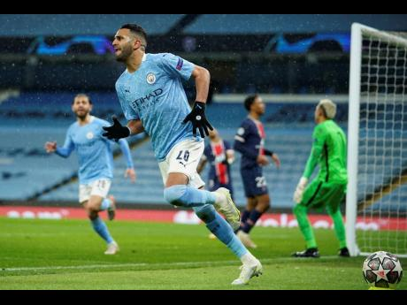 Manchester City's Riyad Mahrez celebrates after scoring his sides second goal during the Champions League semi-final second leg match between Manchester City and Paris Saint Germain at the Etihad stadium, in Manchester, yesterday. Manchester City won 2-0