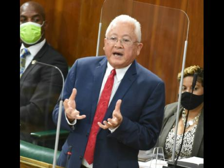 Minister of Justice Delroy Chuck addressing parliamentarians during his Sectoral Debate presentation on Tuesday.