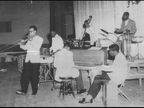 From leftt: Don Drummond, Lennie Hibbert, Aubrey Adams,  Johnny (Stephen) Lawes, Jerome Walters and Kenny Williams play together on December 17, 1957.