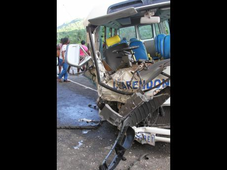 The wreckage of the Clarendon College school bus driven by Keith Dunkley. He succumbed to crash-related injuries on Wednesday.