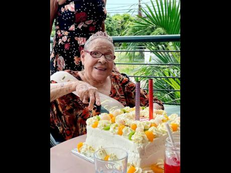 Maysie Culliton-Moore cuts her cake.
