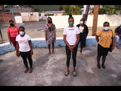 From left: Margaret Brown, Faith Morgan, Patricia Davis, Simone Turner, Sasha Josephs-Bell and Amoya Wong Cohall, who have all lost the fathers of at least one of their children, will benefit from the August Town Children Development Programme, which was l
