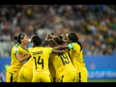 Havana Solaun (obscured) celebrates with Reggae Girlz teammates moments after scoring their first ever goal at the FIFA Women's World Cup against Australia at Stade des Alpes in Grenoble, France on Tuesday June 18, 2019.