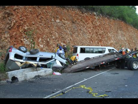The overturned cab (left) which Renford 'Hector' Mowen was driving.