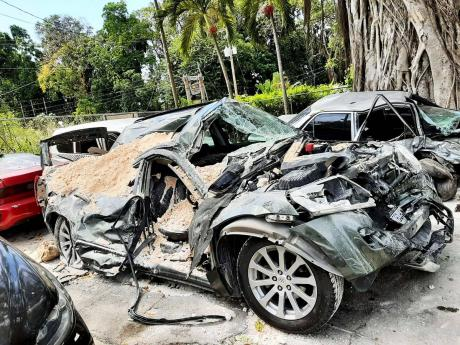 The wrecked Suzuki Grand Vitara, from which two men walked away alive on Thursday, was towed to the Prospect Police Station in St Mary.