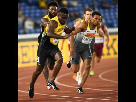 Rasheed Dwyer (background left) hands off the baton to Tyquendo Tracey (foreground left) in the men's 4x100m relay at the World Athletics Relays held in Yokohama, Japan on Saturday, May 11, 2019.