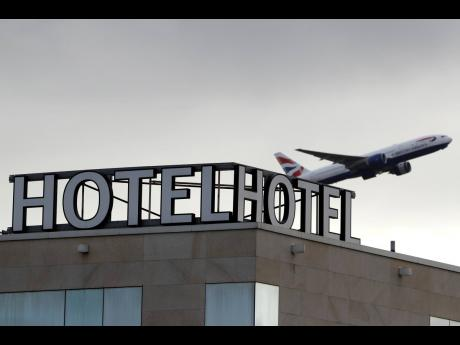 A plane takes off from Heathrow Airport in London, England, on Friday, February 5, 2021.