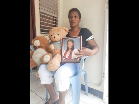 Khanice Jackson's mom, Eunice Chambers, holds a photo of her daughter, along with her teddy bear, as she forecasts what Mother's Day will be like without the 20-year-old, who was killed recently.