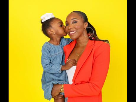 Olympian Sherone Simpson shares a sweet moment with her four-year-old daughter, Leanna.