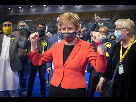 First Minister and SNP party leader Nicola Sturgeon celebrates after retaining her seat for Glasgow Southside at the count for the Scottish Parliamentary Elections in Glasgow, Scotland, on Friday May 7.