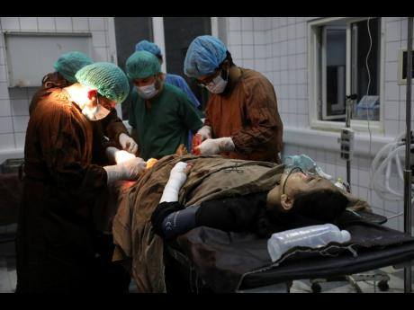 An Afghan school student is treated at a hospital after a bomb explosion near a school west of Kabul, Afghanistan, Saturday, May 8, 2021.