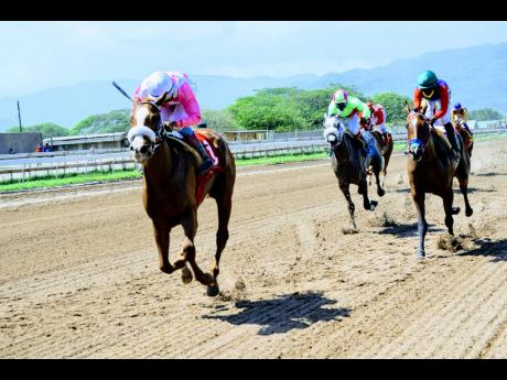 MINIATURE MAN (left) ridden by  Anthony Thomas is a 27-1 long shot winner ahead of the favourite AWESOME LIZ (Omar Walker)  in the ninth race over a Mile at Caymanas Park on Saturday, April 17, 2021.