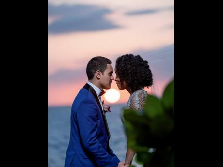 A bride and groom are seen in a romantic moment at a destination wedding coordinated by Francine Foster of Jamaica Wedding Concierge. Foster said that couples and their guests risk losing millions of dollars in event bookings.