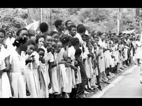 Rural school children and teachers took time off from classes to await the Bob Marley funeral procession at a point near Linstead in St Catherine.