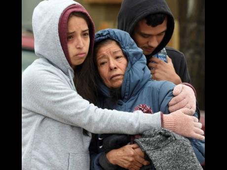 Family members mourn at the scene where their loved ones were killed early on Sunday in Colorado Springs, Colorado.