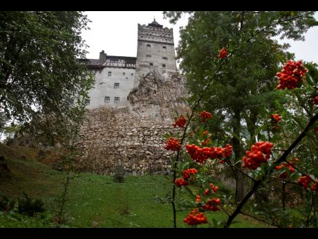 The Gothic Bran Castle, better known as Dracula Castle, is seen on a rainy day in Bran, Romania's central Transylvania region. Romanian authorities have set up a COVID-19 vaccination centre in a medieval building in Bran, not far from the castle, as a me