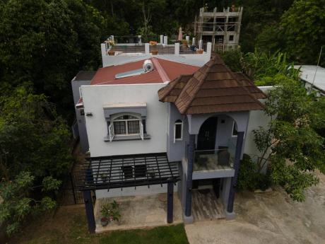 """An aerial photograph of the home of Andrea Gordon. Residents of Havendale say the residence was """"a beauty to behold""""."""