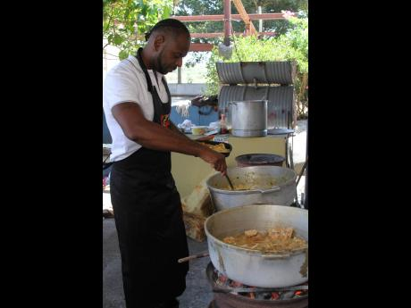 Craig Taylor is  seen cooking for single mothers on Mother's Day at the Singh Quarry in May Pen, Clarendon.