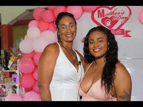 Teneash Hanna (right) and her mother Patricia Dyer were among single mothers who attended the Mother's Day  brunch held at Singh's Quarry in May Pen,  Clarendon.