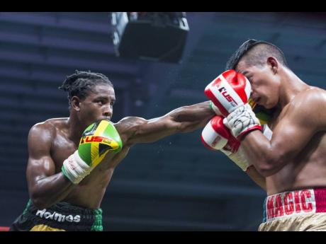 Richard 'Frog' Holmes (left) on the offensive against opponent Ricardo 'Magic Man' Salas during the Wray and Nephew Contender final held at National Indoor Sports Centre on Wednesday, July 25, 2018.