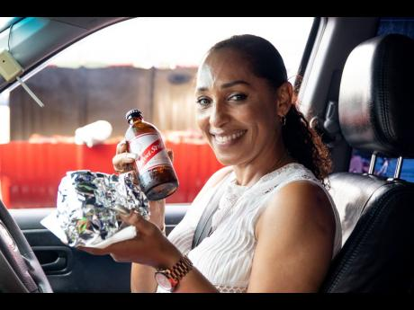 Kathy Stephenson is all smiles as she shows off her favourite food and beer combination.