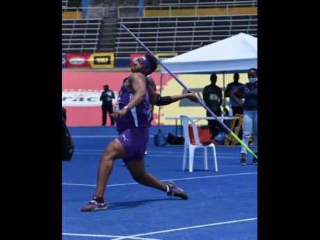 Akeel Hanchard from Kingston College on his way to winning the Boys Javelin Open event at the ISSA/GraceKennedy Boys and Girls' Athletics Championships at the National Stadium yesterday. Hanchard's winning mark was 62.93m