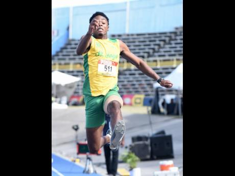 St Jago's Kavian Kerr produces a leap of 7.81m on his last jump to win the Class One boys long jump event  at the ISSA/GraceKennedy Boys and Girls Athletics Championships at the National Stadium yesterday.