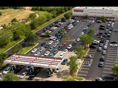 Numerous vehicles line up for gasoline at Costco in Greensboro, North Carolina, on Tuesday, as the shutdown of Colonial Pipeline, a major fuel source, entered its fifth day.