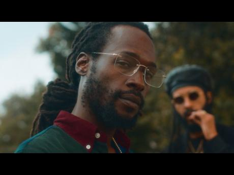 Jesse Royal (foreground) and Protoje in the 'Rich Forever' video.