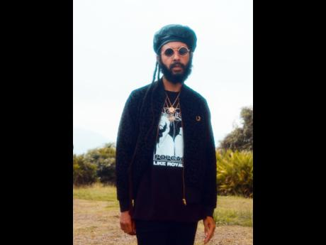 Protoje drew parallels on the 'Rich Forever' set in a Like Royalty Tee from his merchandise shop.