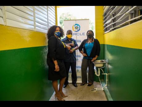 The Ocho Rios High School was the recipient of a sanitisation station, which was donated by the JN Circle Ocho Rios. Participating in the handover are (from left) Winsome McNish-Ricketts, business relationship and sales manager at JN Bank, Ocho Rios and Po