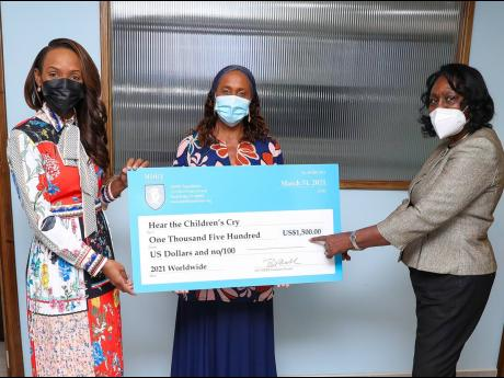 Betty Ann Blaine (centre), managing director, Hear The Children's Cry, accepts a symbolic cheque for US$1,500 from representatives of the Million Dollar Round Table (MDRT) Foundation, (from left) Melia McKitty Plummer, Sagicor Life Corporate Circle branc