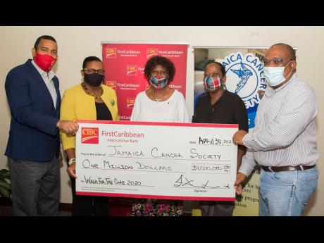 From left: Nigel Holness, managing director of CIBC FirstCaribbean International Bank, and Jerome Griffith, human resource manager at the bank, present the CIBC FirstCaribbean Walk For The Cure cheque for $1 million to Jamaica Cancer Society (JCS) represen