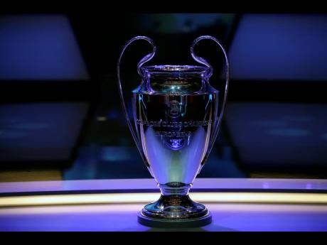The Champions League trophy is displayed before the UEFA group stage draw at the Grimaldi Forum, in Monaco, Thursday, August 29, 2019.