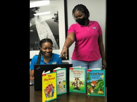 General Accident Insurance's Lisa Hurd is joined by Kerry-Ann Turnbull during the Read Across Jamaica Day activity.  Employees of the insurance giant read to students of the Dunrobin Primary School last week Tuesday during a Live Zoom session.