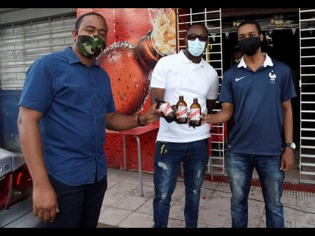 From left: Royan Prince, Kevin Haase and Lancelot Williams enjoy the end of a hectic workweek with a cold beer.