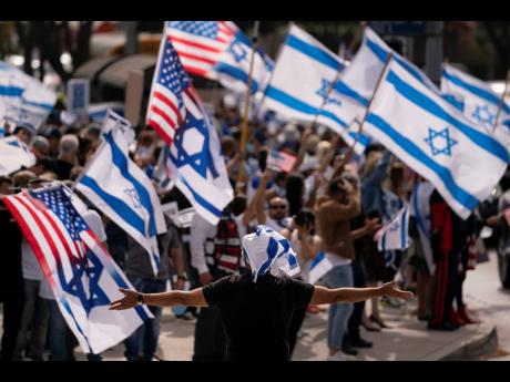 Pro-Israel demonstrators gather outside the Federal Building during a rally in support of Israel in Los Angeles, Wednesday, May 12.