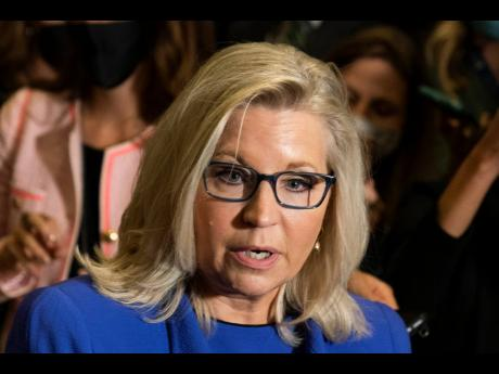 Rep. Liz Cheney, R-Wyo., speaks to reporters after House Republicans voted to oust her from her leadership post as chair of the House Republican Conference because of her repeated criticism of former President Donald Trump for his false claims of election