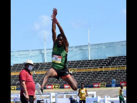 Nathan Wade from Calabar High School competes in the Class Two long jump final at the ISSA/GraceKennedy Boys and Girls' Athletics Championships at the National Stadium yesterday.