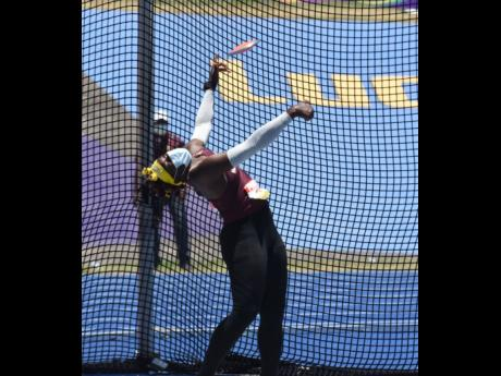 Holmwood Technical's Cedricka Williams on her way to setting a new record of 47.04m in the Girls Class Two discus event at ISSA/GraceKennedy Boys and Girls' Athletics Championships at the National Stadium yesterday.