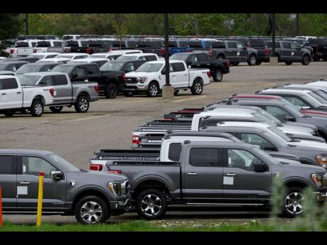 Ford pickup trucks built lacking computer chips are shown in parking lot storage in Dearborn, Michigan, on May 4.