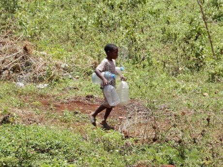 Armed with four plastic bottles, this little boy went in search of water on Tuesday.
