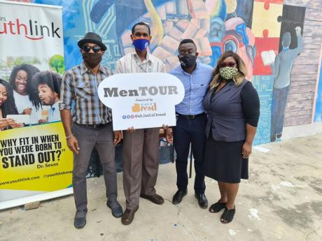 Bridgette Pancho (far right), vice-principal, Dunoon Park Technical High School was elated to have Foska Oats and the Youthlink-sponsored MenTOUR donating care packages to her school.  From left are: Kareem LaTouche, acting vice-principal Altino Facey, and