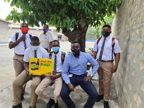 Stephen Reid, representative of Chas. E. Ramson, along with some upper school students of Dunoon Park Technical High School.