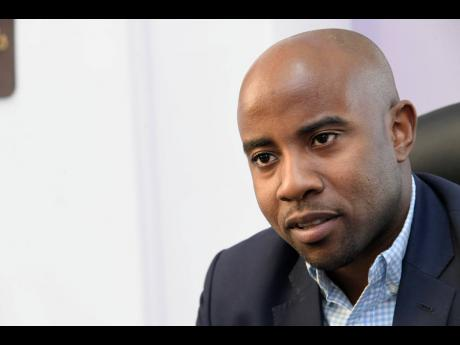 Ryan Reid, CEO of First Rock Capital Holdings Limited.