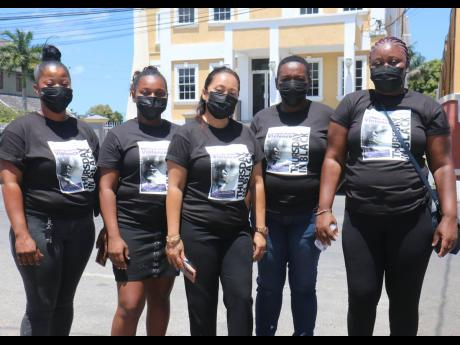 Protesters against domestic violence participate in a silent demonstration on Great George Street, Savanna-la-Mar, on Thursday. From left are: Tia Rainford, Shelly-Kay Mitchell, Julian Chang (founder of Westmoreland Trauma Hotline Foundation), Judith Hutch
