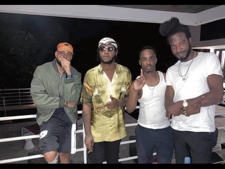 From left: Stylist Chris, Teejay, Government Cheese and Gyptian take a break in the middle of shooting the video for 'Uptop Wine'.