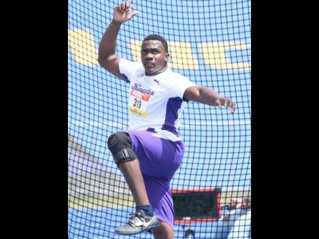 Kingston College's Ralford Mullings competes in the Class One boys discus event at the ISSA/GraceKennedy Boys and Girls' Athletics Championships at the National Stadium on May 13, 2021. Mullings won with a mark of 61.92m.