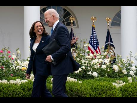 Vice-President Kamala Harris and President Joe Biden smile and walk off after speaking about updated guidance on mask mandates, in the Rose Garden of the White House, yesterday.